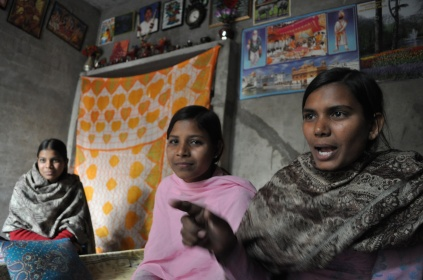 From right to left, Savita, 18, Rekha 15, and Kirin, 20, in their shared bedroom